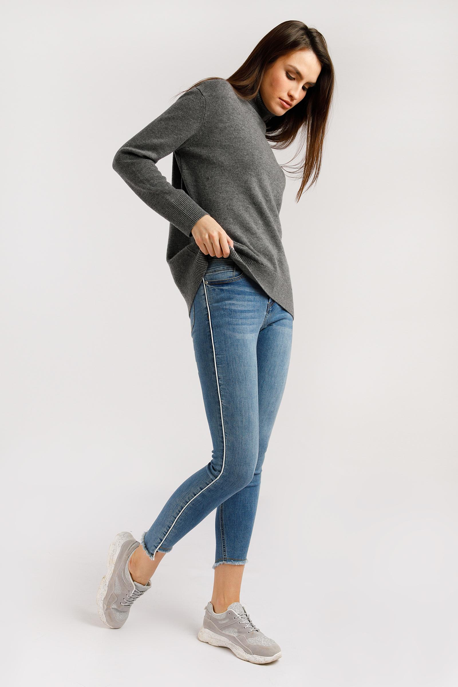 Брюки женские (джинсы) фото